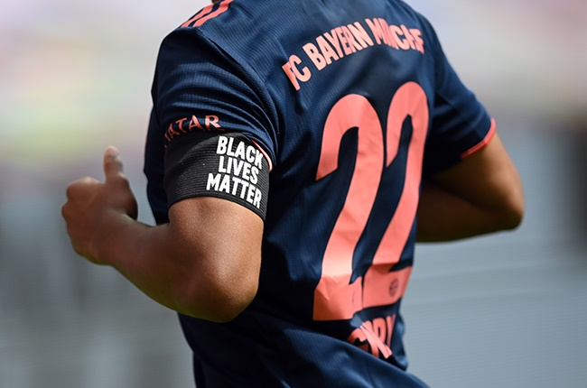 Serge Gnabry of Bayern Munich wears an armlet reading Black Lives Matter during the Bundesliga match against Leverkusen at BayArena on 6 June 2020 (Photo by Matthias Hangst/Getty Images)