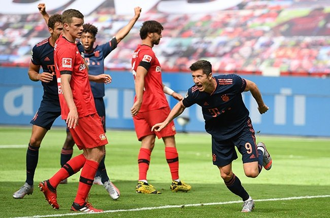 Bayern Munich's Robert Lewandowski celebrates his team's fourth goal during the Bundesliga match against Bayer Leverkusen at BayArena on 6 June 2020. (Photo by Matthias Hangst/Getty Images)