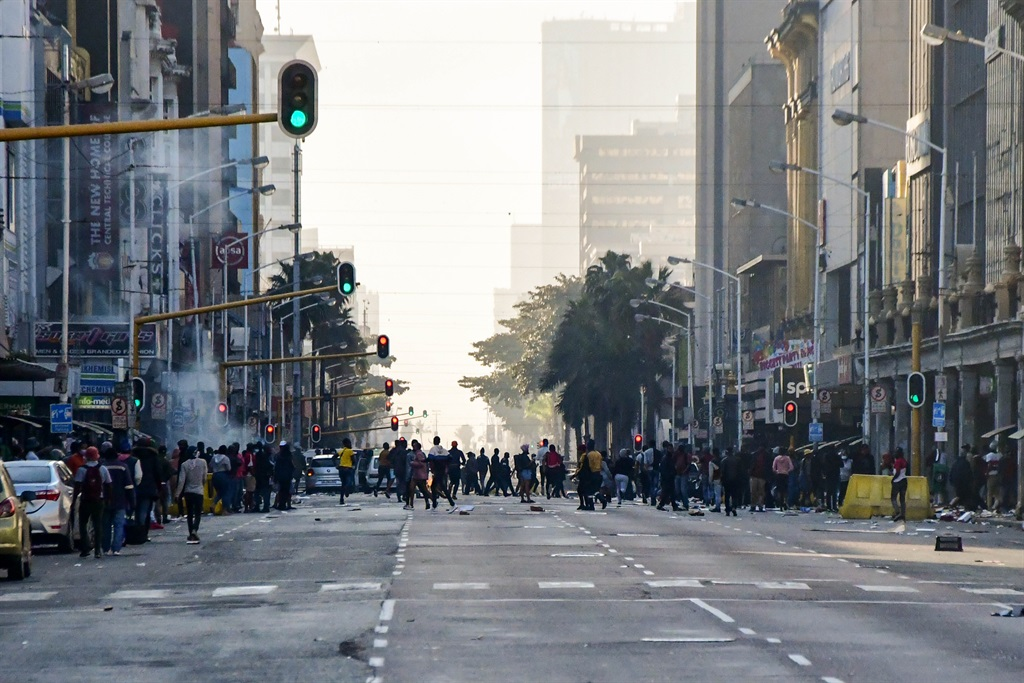 DURBAN, SOUTH AFRICA - JULY 12: Looters in the dis