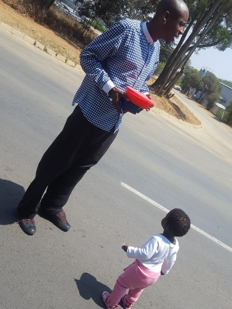 Mpho Mokola with his daughter Rethabile., who he named his crowdfunding campaign after. Mokola said he has resorted to taking pictures away from his area to avoid people's stares. Picture: Provided