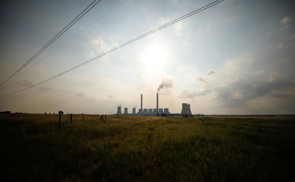 Power lines are seen in front of the Duvha coal-based power station owned by state power utility Eskom, in Mpumalanga. Picture: Mike Hutchings/Reuters