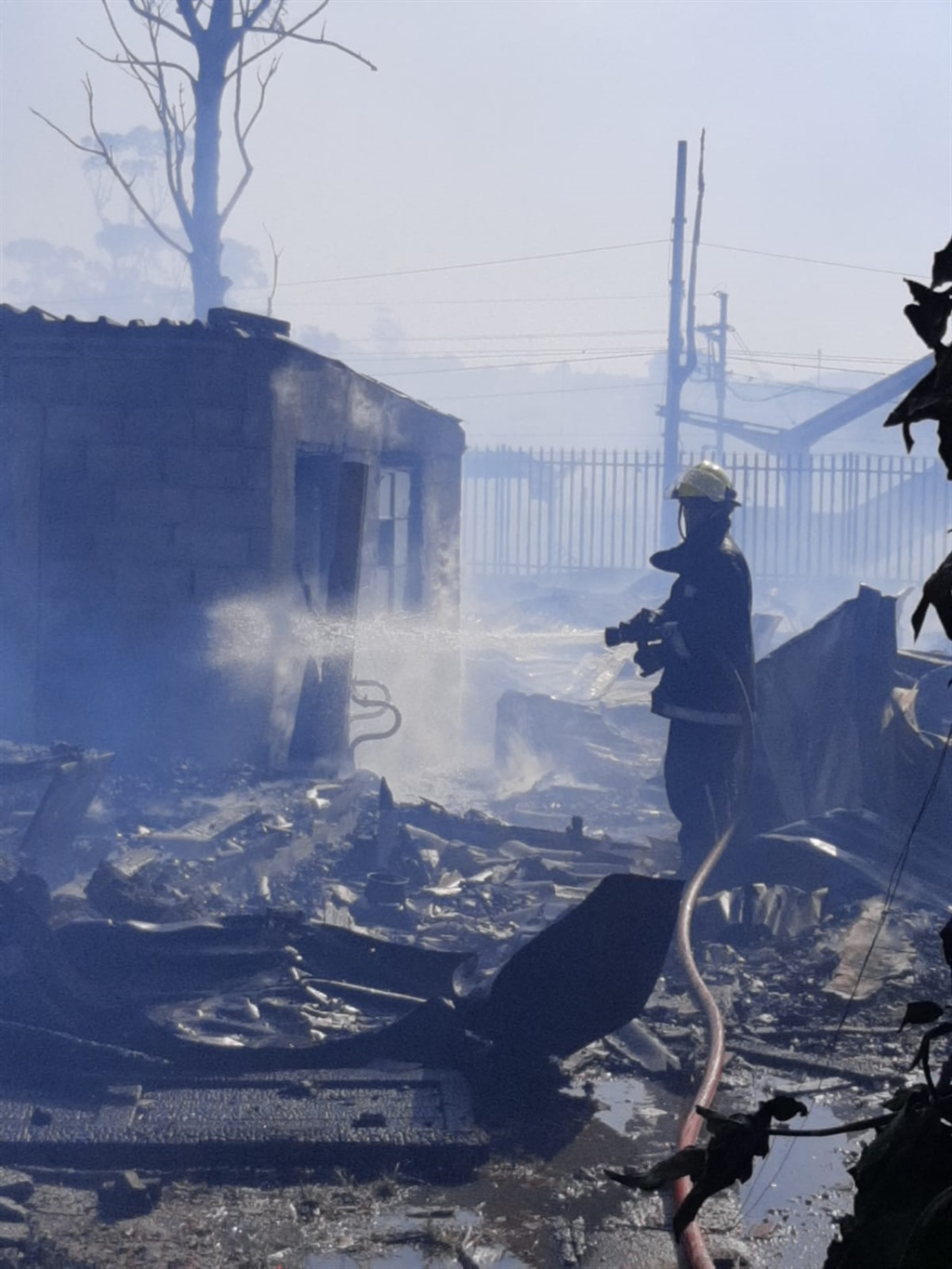 Fire being extinguished in KwaMashu