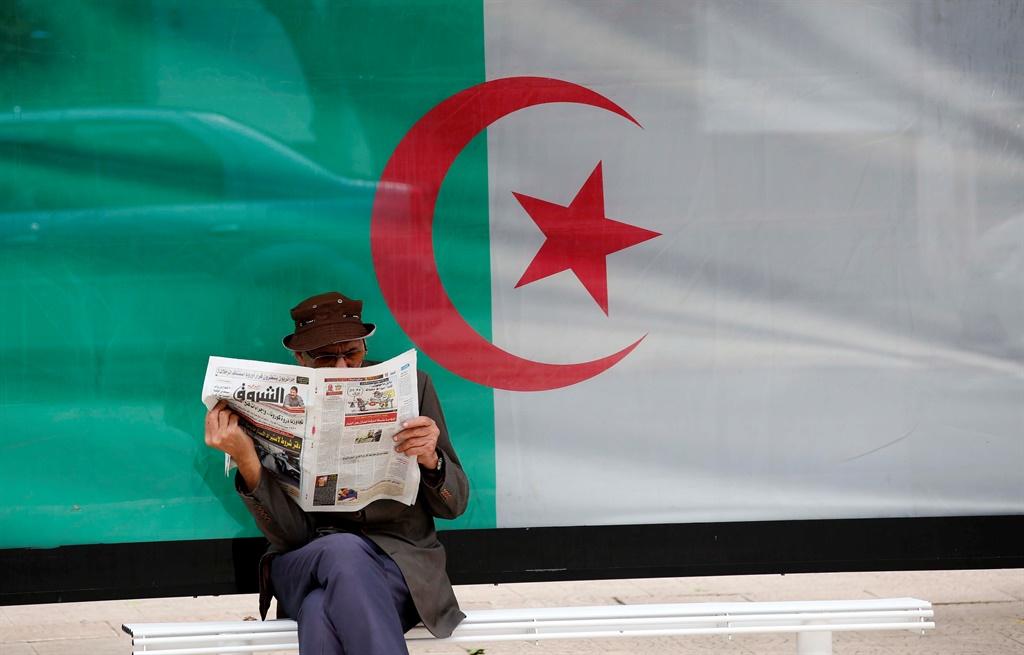 A man reads a newspaper in Algiers, Algeria. Picture: Billal Bensalem/NurPhoto via Getty Images