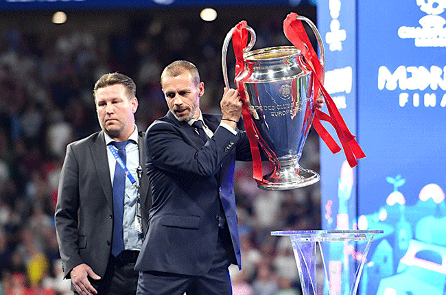 Aleksander Ceferin with Champions League trophy