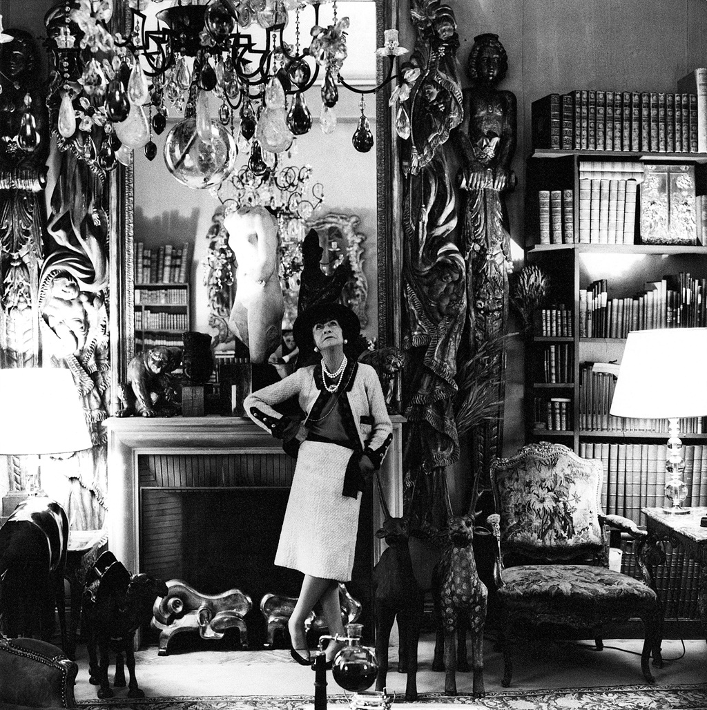 French fashion designer, Coco Chanel, standing, in