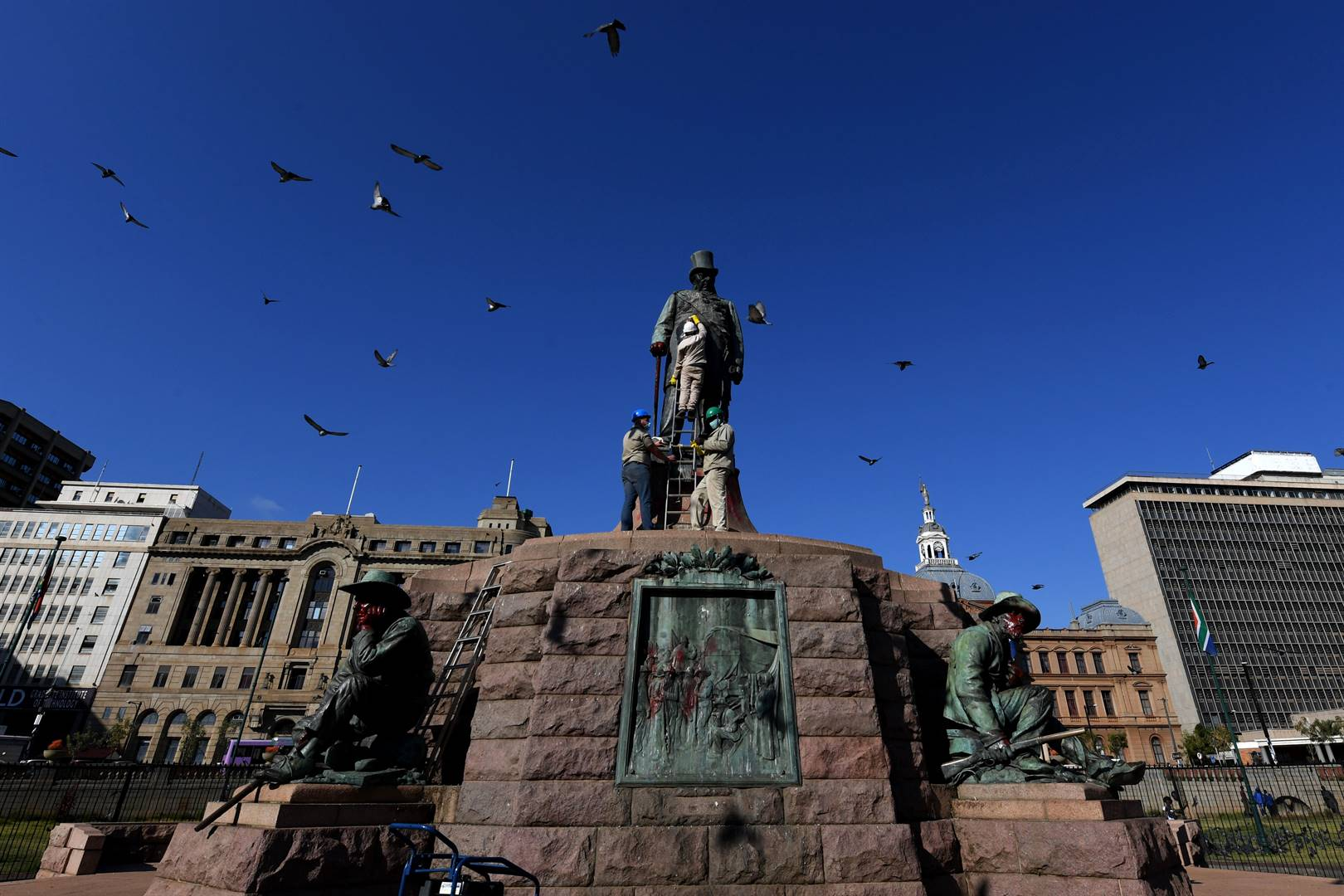 The statue of Paul Kruger on Church Square in Tshwane gets cleaned after it was vandalised with red paint.