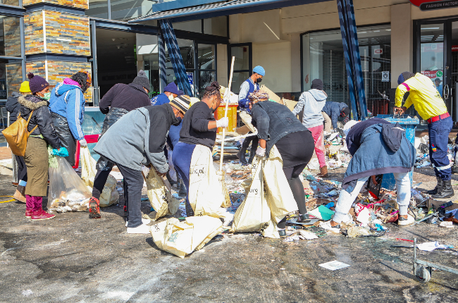 The community embarked on clean-up and rebuilding operations at Jabulani Mall, Soweto. Photo: Sharon Seretlo/Gallo Images