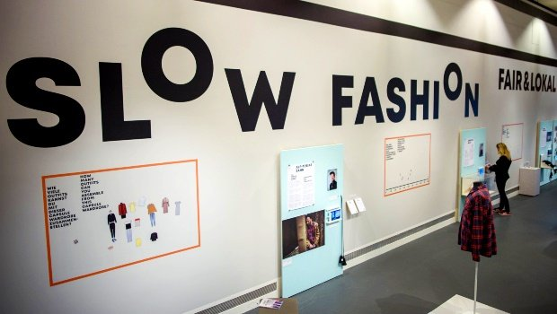 """The writing """"Slow Fashion - Fair & Lokal"""" is in the special exhibition """"Fast Fashion. The dark sides of fashion"""" in the Museum of European Cultures. Photo by Gregor Fischer/picture alliance via Getty Images"""