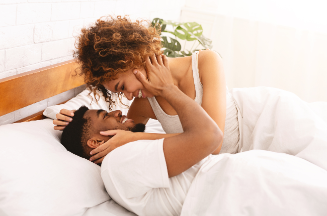 Couple in bed.