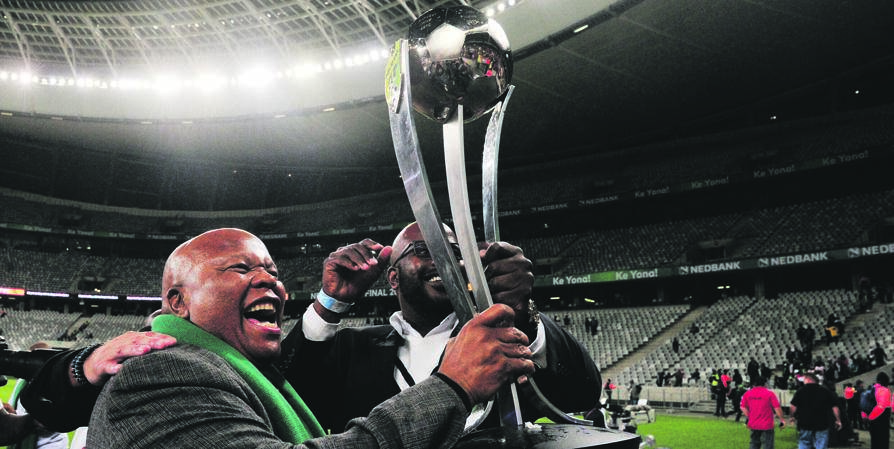 Mike Mokoena and his son Rantsi hold aloft the Nedbank Cup after Free State Stars beat Maritzburg United in the 2018 final. Picture: Ryan Wilkisky / BackpagePix