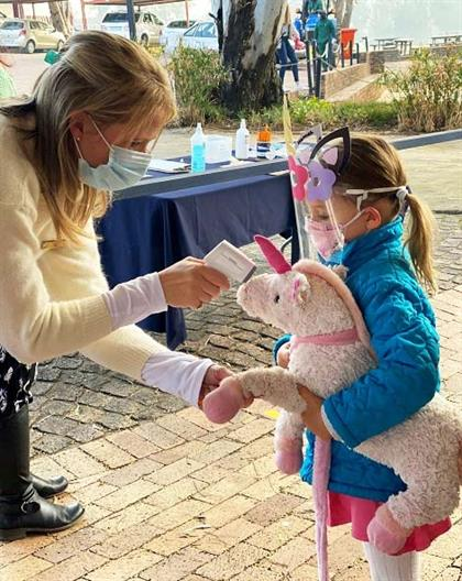 Little girl get teddy's temperature checked
