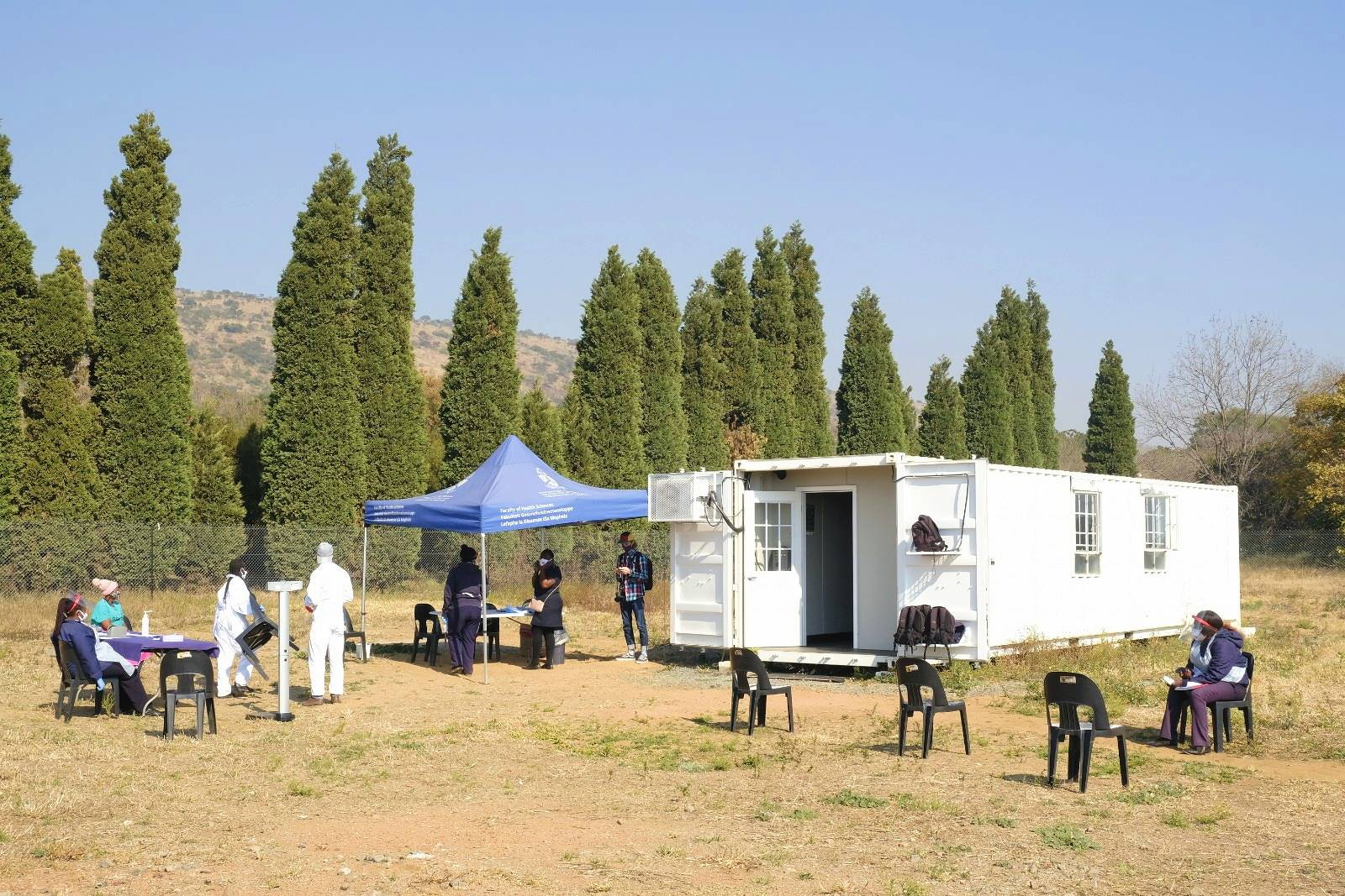 To reduce infection risk, the Melusi clinic is operating outside, with only one patient allowed inside the container at a time. Picture: Elna Schütz/Spotlight