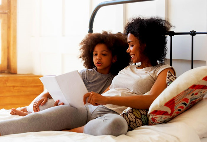 Encourage your child to keep practising to improve their reading.(fizkes/Getty Images)