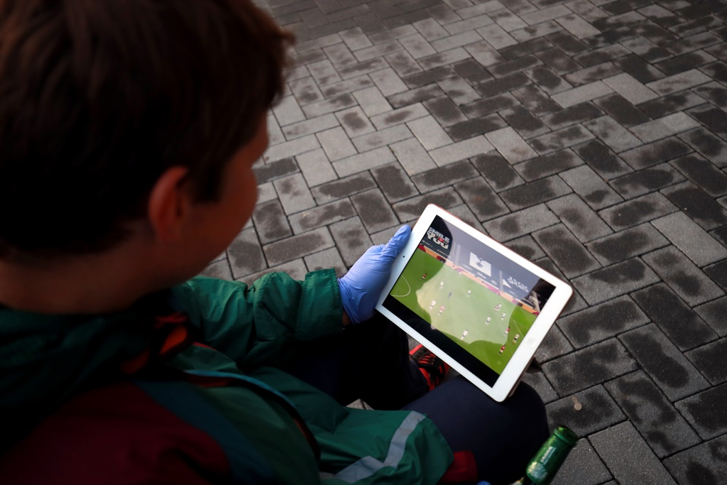 A Manchester United fan watches the match on his iPad outside the Tottenham Hotspur Stadium. Picture: Adam Davy/PA Images via Getty Images