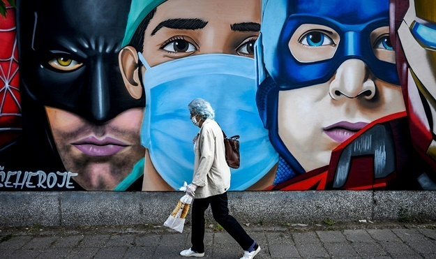 A mural depicting a medical worker among well-known fictional super heroes in Novi Sad. (Andrej Isakovic, AFP)