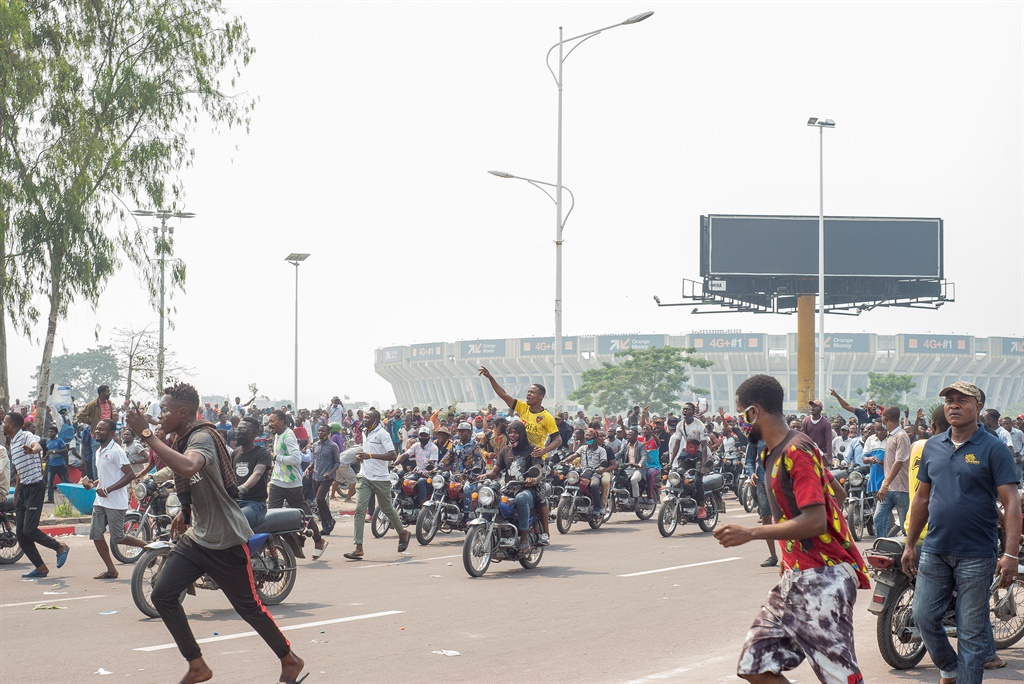 Protesters demonstrate around Parliament in Kinshasa.