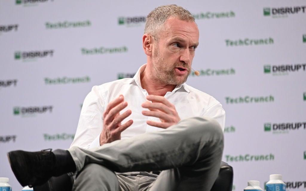 The CEO of Prosus and Naspers, Bob van Dijk, speaks on stage at TechCrunch Disrupt Berlin 2019 at Arena Berlin on December 11, 2019.