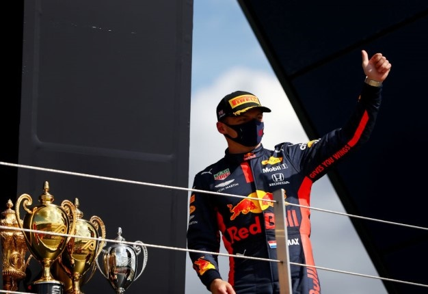 Max Verstappen celebrates on the podium after finishing second in the Formula One Grand Prix of  Britain.  (Photo by Dan Istitene - Formula 1/Formula 1 via Getty Images)