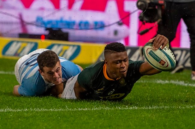 Springbok wing Aphiwe Dyantyi scores a try during the Rugby Championship against Argentina at Kings Park in Durban on 18 August 2018.