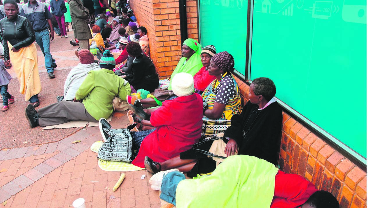 VBS Mutual Bank customers queue outside one of the bank's branches, hoping to withdraw money they saved for stokvels and burial societies on June 20 2018 in Thohoyandou. The ANC has reinstated two Limpopo officials implicated in the looting and collapse of the bank, but account holders are still waiting for their money almost two years later. Picture: Gallo Images