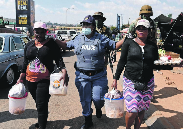 Two women were arrested by police for selling cakes and snacks on the pavements without a permit during lockdown regulations in Soweto in April.                                                  Picture: Tebogo Letsie