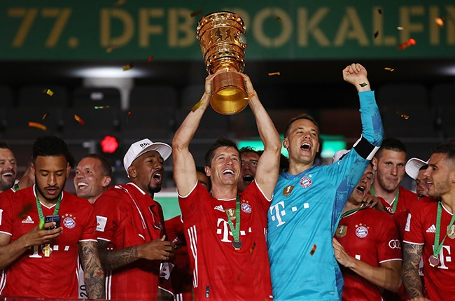 Bayern Munich's Robert Lewandowski lifts the trophy in celebration with his team-mates after the German Cup final against Bayer Leverkusen at Olympiastadion in Berlin on 4 July 2020.