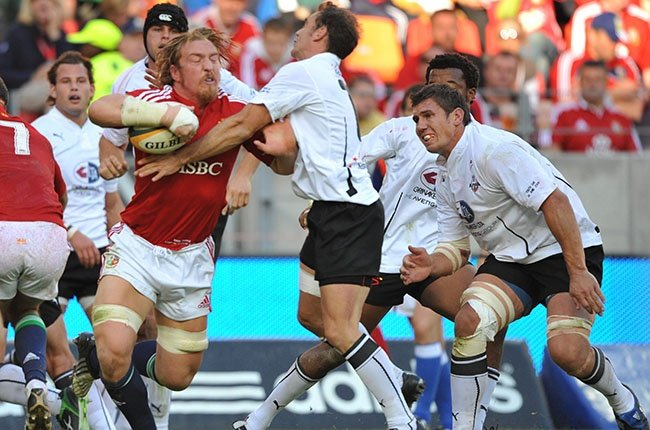 Andy Powell tackled by Jaco van der Westhuizen during the British and Irish Lions' tour match against the Southern Kings at Nelson Mandela Stadium in Port Elizabeth on 16 June 2009. (Gallo Images)