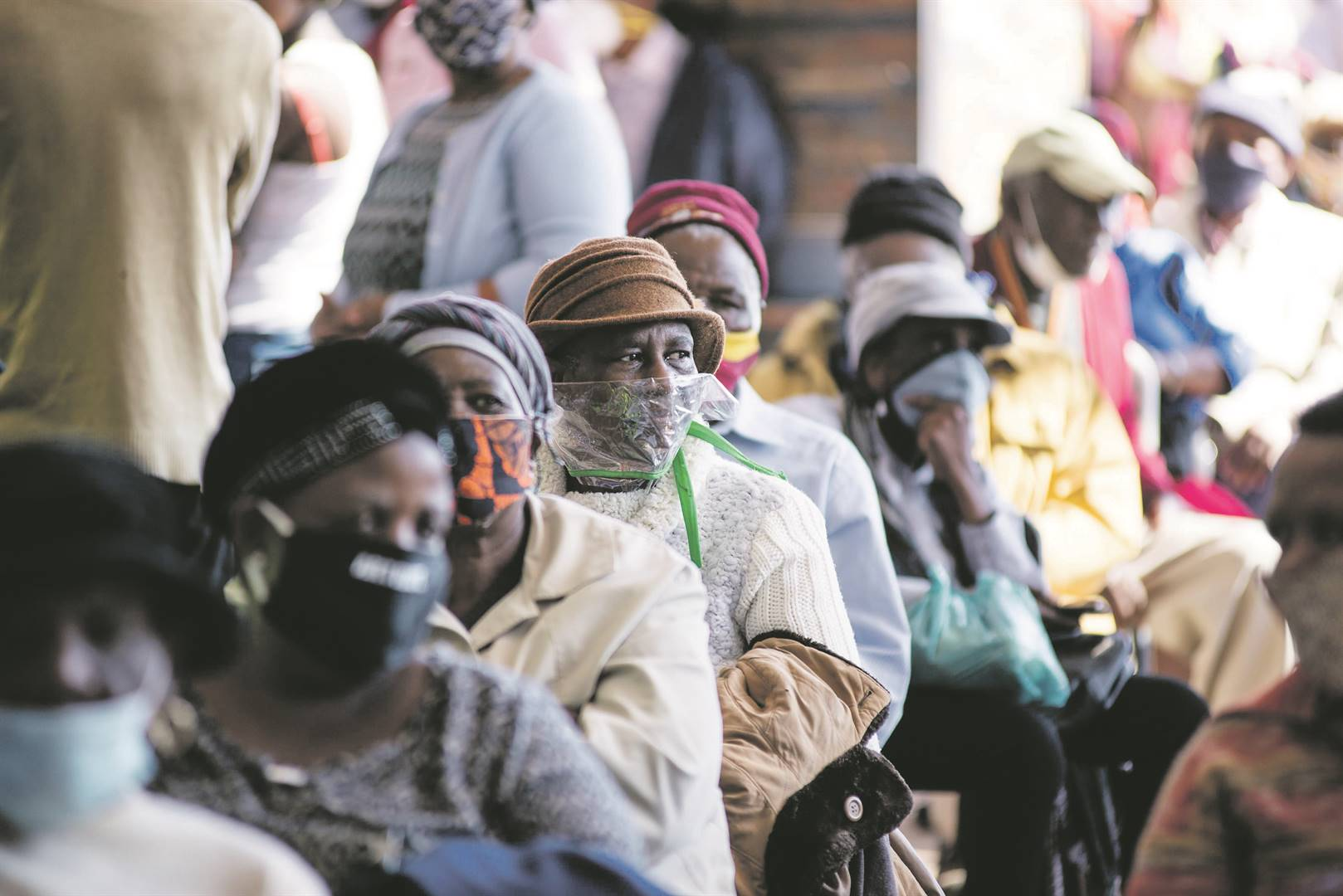 Senior citizens queue for their social grants outside Jabulani Mall in Soweto in May. Projections for 2030 suggest that more than 300 million people in sub-Saharan Africa will still be living in extreme poverty.Picture: ER Lombard / Gallo Images