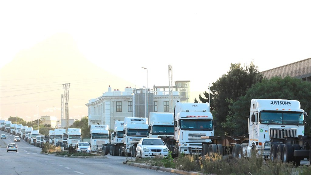 CAPE TOWN, SOUTH AFRICA - MAY 13: Trucks line the