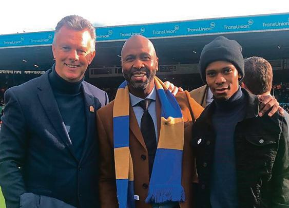 Lucas Radebe flanked by his former coach David O'Leary and son Lucas during Leeds' centenary celebrations last year