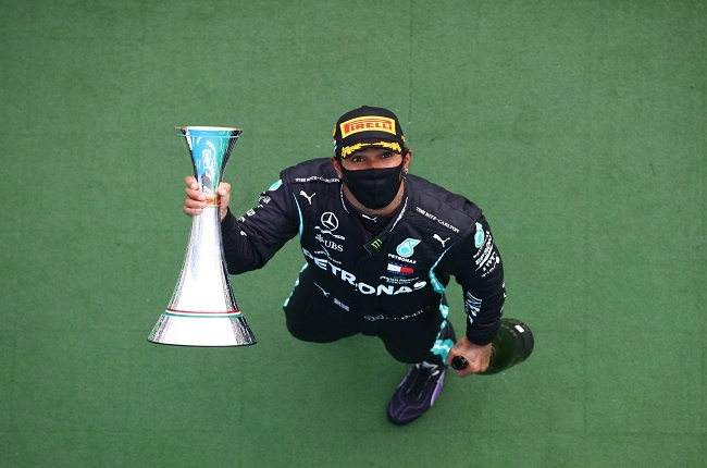 Mercedes British driver Lewis Hamilton celebrates with the trophy after winning the Formula One Hungarian Grand Prix race at the Hungaroring circuit in Mogyorod near Budapest, Hungary, on July 19, 2020. (Photo by Mark Thompson / POOL / AFP)