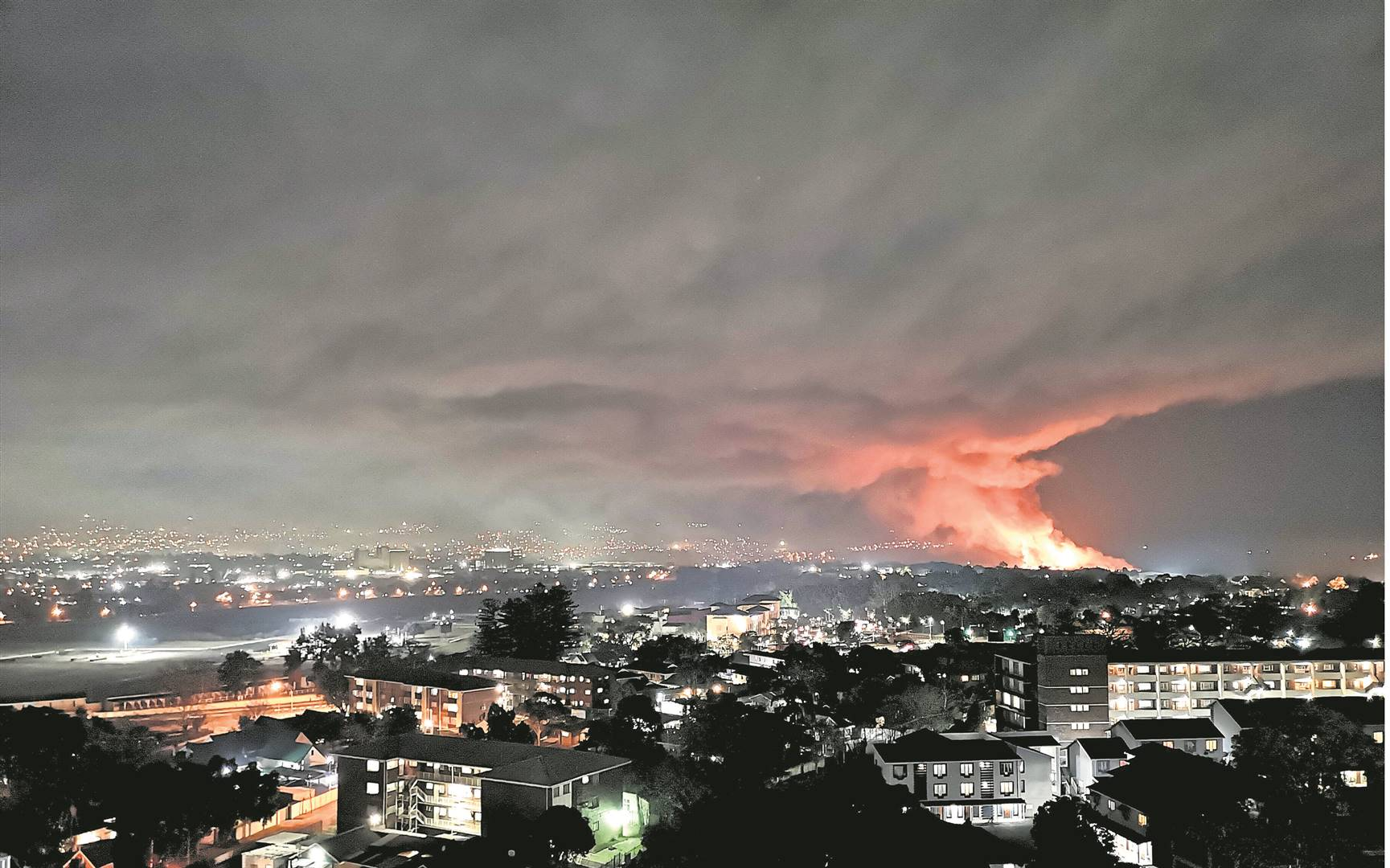 Meleney Naik took this photograph of the New England Road landfill site still well ablaze last night, from the Nedbank Plaza highrise in Scottsville. PHOTO: Meleney Naik