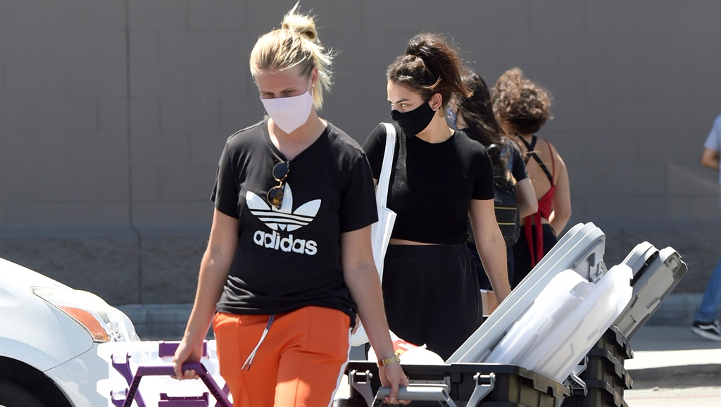 Charli XCX and her friend purchase a few plastic storage containers from Target amid the Covid-19 pandemic in Los Angeles, California. The 28 year old singer kept it casual in a black top, black sweatpants and Converse sneakers. Photo by The Image Direct/ Magazine Features