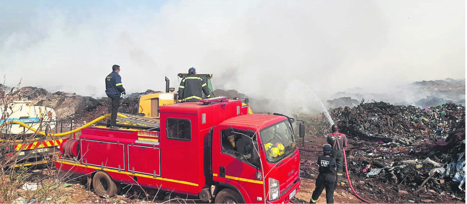 The Working on Fire KZN team has joined the battle to contain the New England Road Landfill fire. PHOTO: WOF KZN