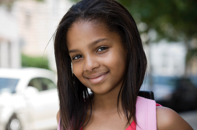 A young girl with healthy relaxed hair