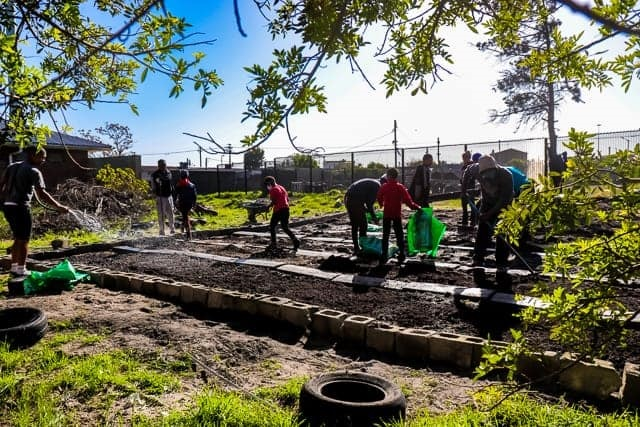 Young and old work on their community garden.