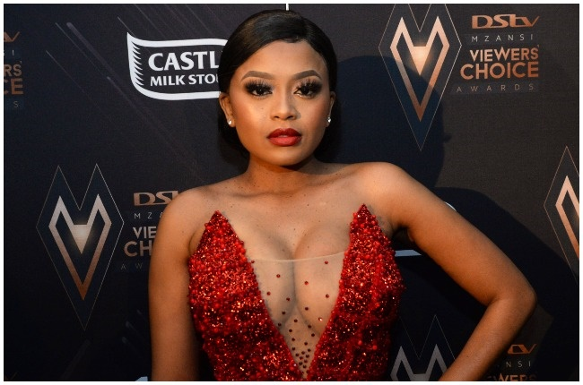 Lerato Kganyago donates a number of blankets to the homeless.
