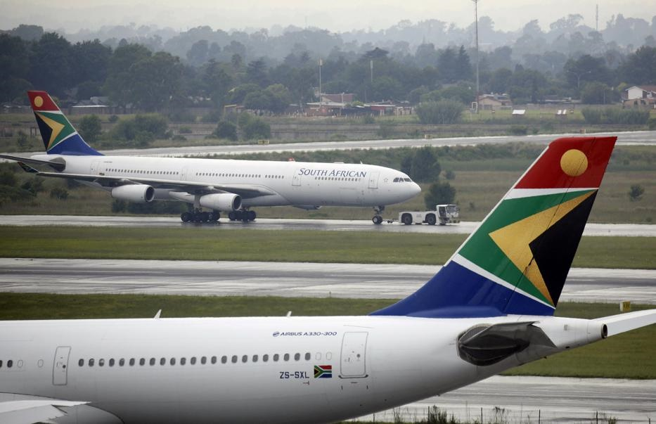 A South African Airways (SAA) plane is towed at OR Tambo International Airport. Picture: Rogan Ward/Reuters