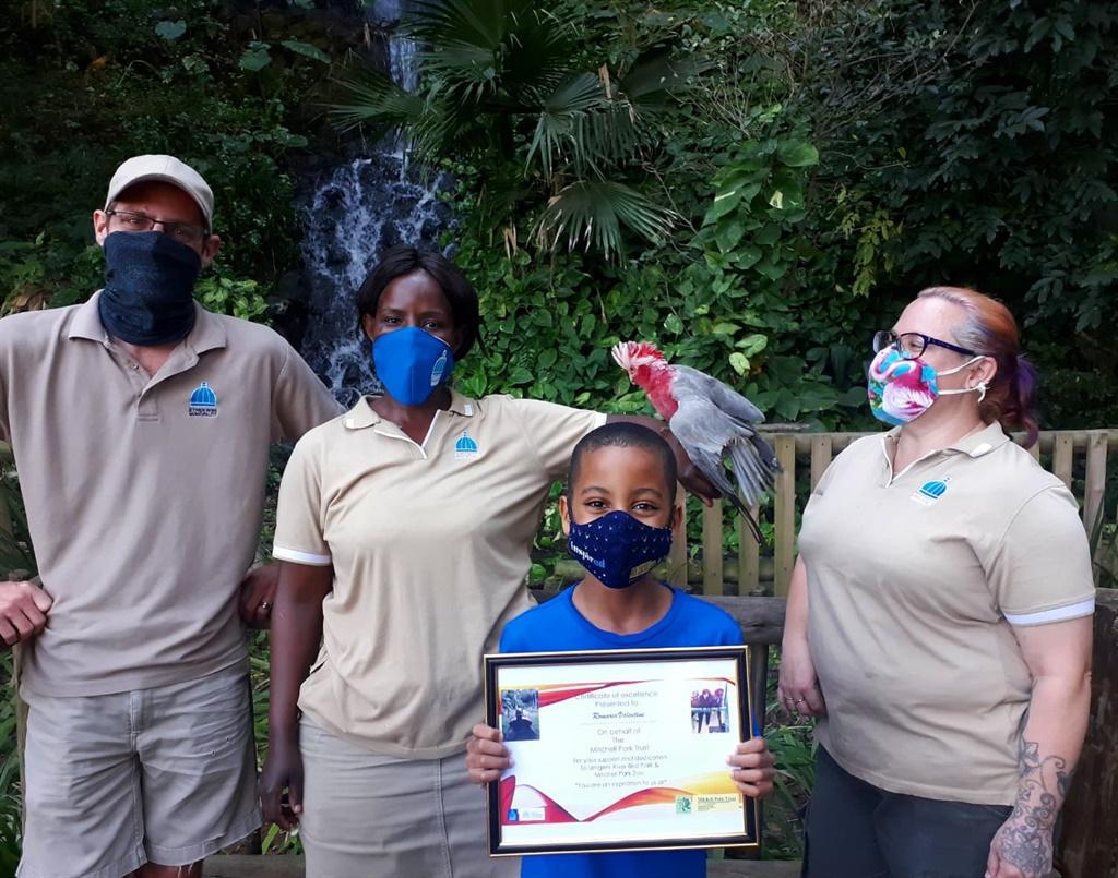 Romario Valentine with staff at the Umgeni River Bird Park.