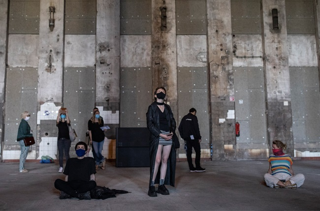 """Visitors listen Tamtam's sound installation """"Eleven Songs – Halle am Berghain"""" at Berghain club on July 26, 2020 in Berlin, Germany."""