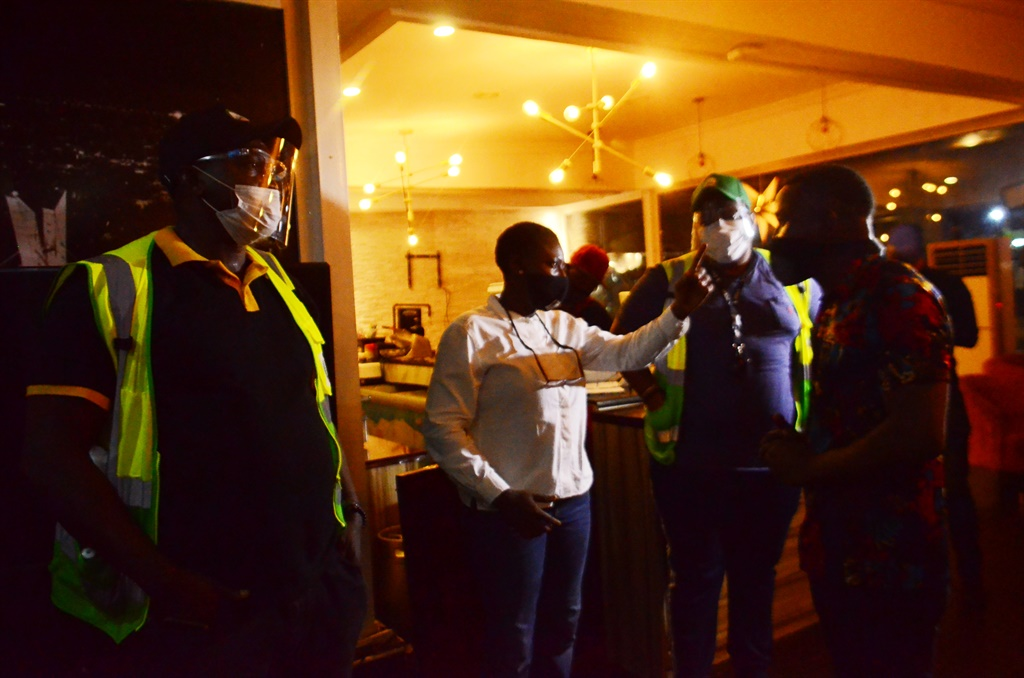 Officials of Lagos State Environmental Protection Agency discussing with manager of a bar/restaurants while inspecting/seal off hospitality business violators. Picture: Olukayode Jaiyeola/NurPhoto via Getty Images