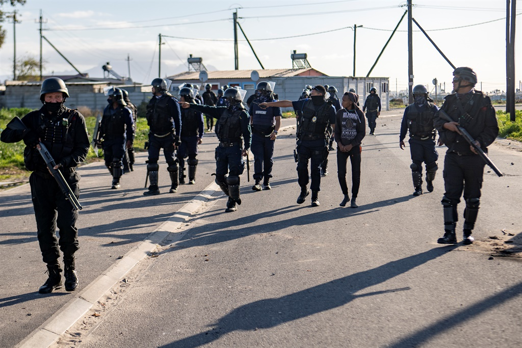 Cape Town metro cop wounded in petrol bomb attack in Kraaifontein during land protests - News24
