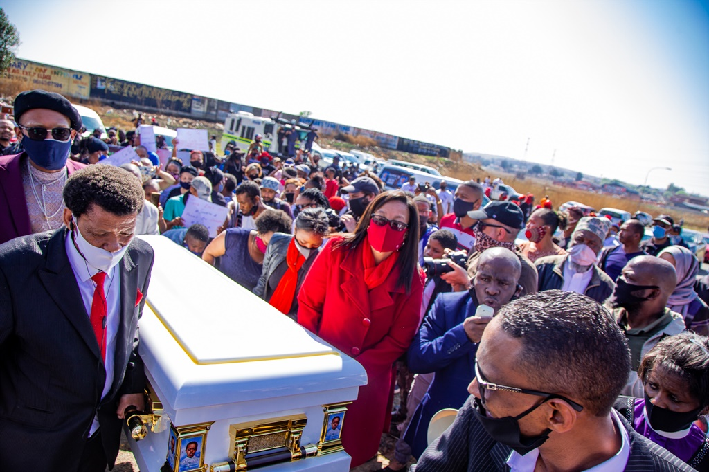 Friends and family attend the funeral service of Natheniel Julies in Eldorado Park.
