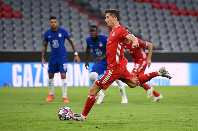 Bayern Munich's Robert Lewandowski scores his side's first goal from the penalty spot during the Champions League round of 16 second leg match against Chelsea in Munich on 8 August 2020.