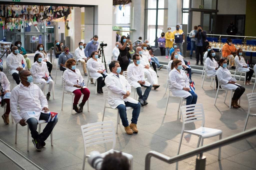 Cuban doctors during a welcome ceremony for Cuban health workers who were deployed to the Western Cape to support efforts in the fight against Covid-19 on 24 May in Cape Town.