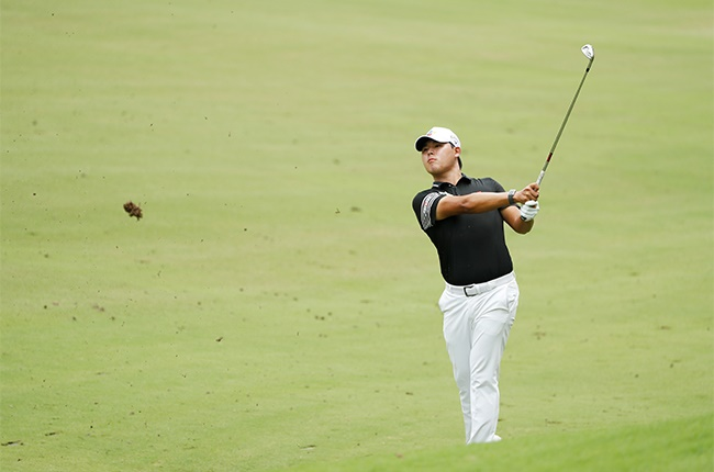 Si Woo Kim of South Korea plays his second shot on the 17th hole during the third round of the Wyndham Championship at Sedgefield Country Club on August 15, 2020 in Greensboro, North Carolina.