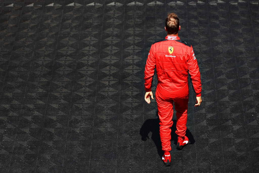 BARCELONA, SPAIN - AUGUST 16: Sebastian Vettel of Germany and Ferrari walks to the grid before the F1 Grand Prix of Spain at Circuit de Barcelona-Catalunya on August 16, 2020 in Barcelona, Spain. (Photo by Mark Thompson/Getty Images)
