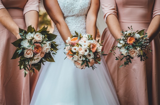 Bride and her bridesmaids showing off their beautiful bouquets. (PHOTO: Gallo Images/Getty Images)