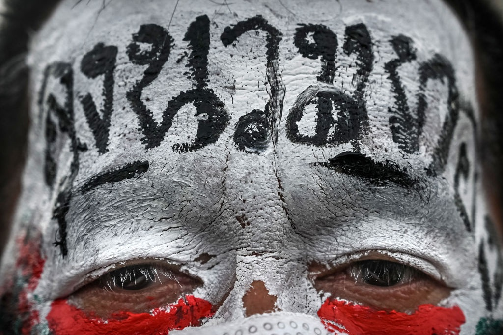 A protester with a political message painted on his face poses for a picture during a car mob rally in Bangkok, Thailand. (Photo by Sirachai Arunrugstichai/Getty Images)