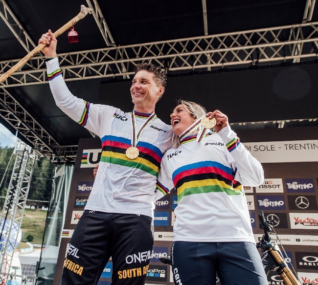 Greg Minnaar and Myriam Nicole celebrate at UCI DH World Championships in Val di Sole, Italy (Photo: Red Bull Content Pool)